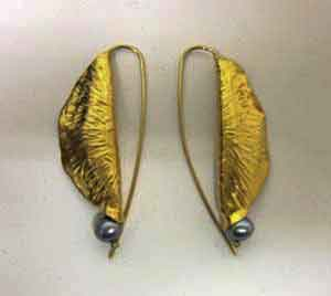Hand Wrougnt 24k gold earrings made with black pearl by Goldsmith Ruth Rhoten
