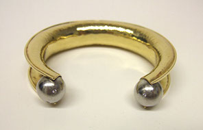 18k yellow gold bracelet with platinum spheres set with small diamonds. Anti clastic raising, all hand fabricated by Ruth Rhoten, Goldsmith